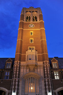 Clock tower lit up at night></section><section class=