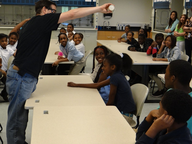 Dr. Mark Waner showing the students a science experiment.