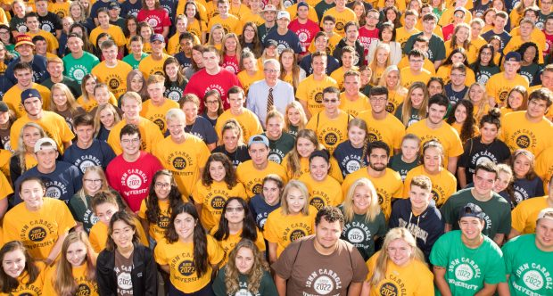 image - President Michael Johnson surrounded by the Class of 2022