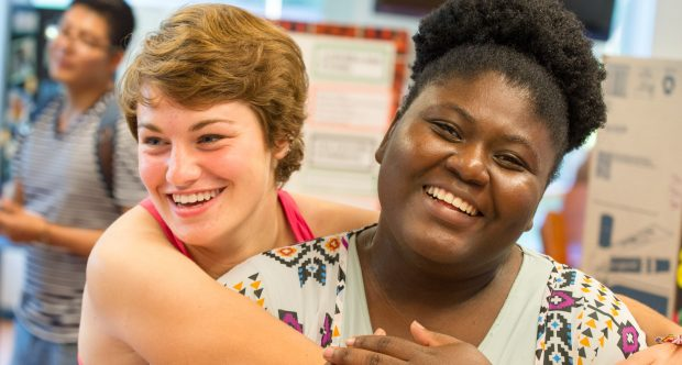 image - two JCU students hugging, laughing