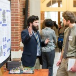 Brad Doughty presents his SHP, including a working model of a traffic signal redesign, to Poster Competition judge Adam Green.