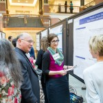 """Megan Crippen presents her SHP, """"Theories of Victim Blame,"""" to Fr. Niehoff and Dr. Ehrhardt"""