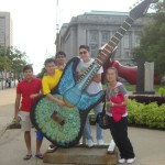 JCU students in front of the Free Stamp in downtown Cleveland's Willard Park.