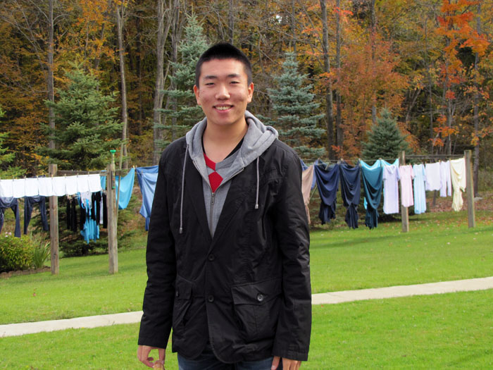Posing by some Amish clothing hanging to dry