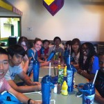 Students and peer mentors having lunch at Cedar Point