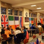 Students eating under flags during the Global Family Dinner