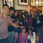 Students and server at Hard Rock Cafe