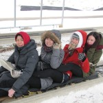 Students at the end of their toboggan ride