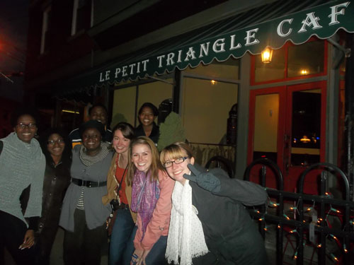 Students posing in front of Le Petit Triangle French restaurant