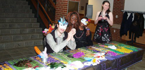 Students with Mardi Gras inspired masks.