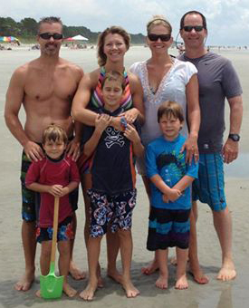 From left: John Slatniske '91, Lara Vidmar Slatniske '94, Melissa Lohman Manner '94, Kevin Manner '93. Kids in front are Brody (age 6) and Brennan (age 9) Slatniske and Wyatt Manner (age 6).