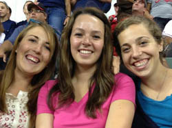 Sarah Stanley, Marybeth Stucker, and Emily Herfel enjoy a Tribe game in Cleveland.