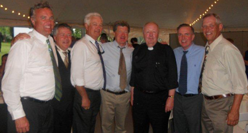 From left: Joe Sullivan, Tom Kelly, Mike Skerl, Mike Behm, newly ordained Rev. Mark Danisewicz, Mike McGuigan, and John Hurley
