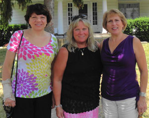 From left: Kathy (Norris) Michael, Mary Ann (Osgood) Morrison, and Sue (D'Orazio) Generazio reunited this summer in front of the home they lived in their senior year at Carroll on E. Derbyshire Rd. in Cleveland Heights.