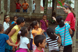 Maris Howell '15 plays with children in Calpules.