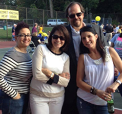 Homecoming reunion (from left): Laryn Runco '84, Michelle (McNulty) Flando '89, Dave Clifford '87, and Lisa (Verszyla) Cantalamessa '88
