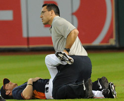 Beiting helps stretch an Astros player before a game against the Los Angeles last year.