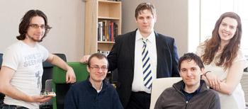 Part of the DragonID team (from left): Ilya Malinskiy, technical engineer; James Gifford, junior engineer; David Vodolazkiy '13, communications director; Eugene Malinskiy '08, CEO; and Christine Fleig '14, market analyst.