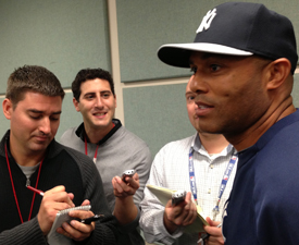 Boland (left) in a group of reporters talking to New York Yankees closer Mariano Rivera in 2013.