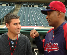 Boland chats with former Cleveland Indians catcher Sandy Alomar, now a part of Terry Francona's coaching staff.