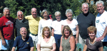 Classmates gather: John Breznai, Tom McGann, Marty Dempsey, F.X. Walton, Bill Marks, and Jerry Burke. Annie Marks, Kathy Walton, Donna Breznai, Louise McGann, Bonnie Burke, and Davy Dempsey also joined the group.