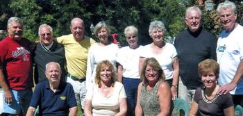 Classmates gather: John Breznai, Tom McGann, Marty Dempsey, F.X. Walton, Bill Marks, and Jerry Burke. Annie Marks, Kathy Walton, Donna Breznai, Louise McGann, Bonnie Burke, and Davy Dempsey also joined the group.