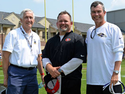 Frank Navratil, Ph.D., JCU finance and economics professor, visited the Baltimore Ravens training facility when the Ravens were practicing and scrimmaging with the San Francisco 49ers. He met with Pat Moriarty '93G (right), senior vice president of football administration, and Greg Roman '94, former offensive coordinator for the 49ers.