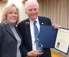 Larry Faulhaber shows his community service award from Lakewood Hospital to Rocky River Mayor Pam Bobst.