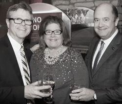 Dave Robinson, Molly (Gibbons) Robinson '75, and Roger Hull at the Conway MacKenzie Christmas party.