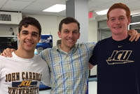 Matt Mihalich '10, a teacher at Bishop O'Connell High School in Arlington, Va., poses with incoming freshmen Gabe Susinski (left) and Ed Gleeson.