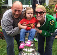 John, Grace, and Molly (Smith) Sheridan '99 celebrated the Chicago Blackhawks 2015 victory with the Stanley Cup.