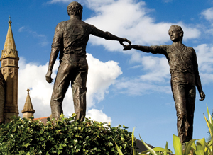 The Hands Across the Divide monument in Derry, Northern lreland, near the Craigavon Bridge symbolizes the spirit of reconciliation and hope for the future. It was unveiled in 1992, 20 years after Bloody Sunday. The bronze sculpture was designed by Maurice Harron, a teacher in Derry.