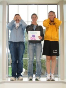 Three girls covering eyes, ears and mouth