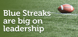 Fottball on field with the text: Blue Streaks are big on leadership