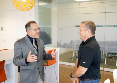 Al Miciak of Boler and Mike Quinn of OMNOVA have a discussion before the award ceremony.