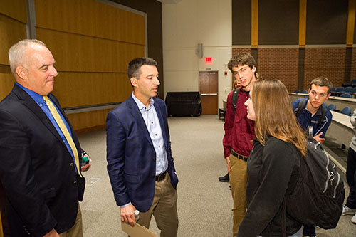 Tom Telesco meets with a student in Donahue Auditorium