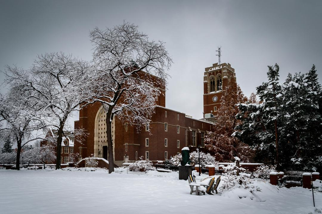 Beautiful photo of our administration building with the tower in full view, as the campus is covered in snow.