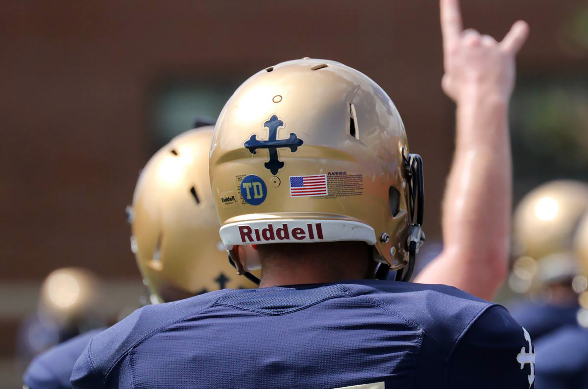 jcu football player wearing helmet facing away from camera
