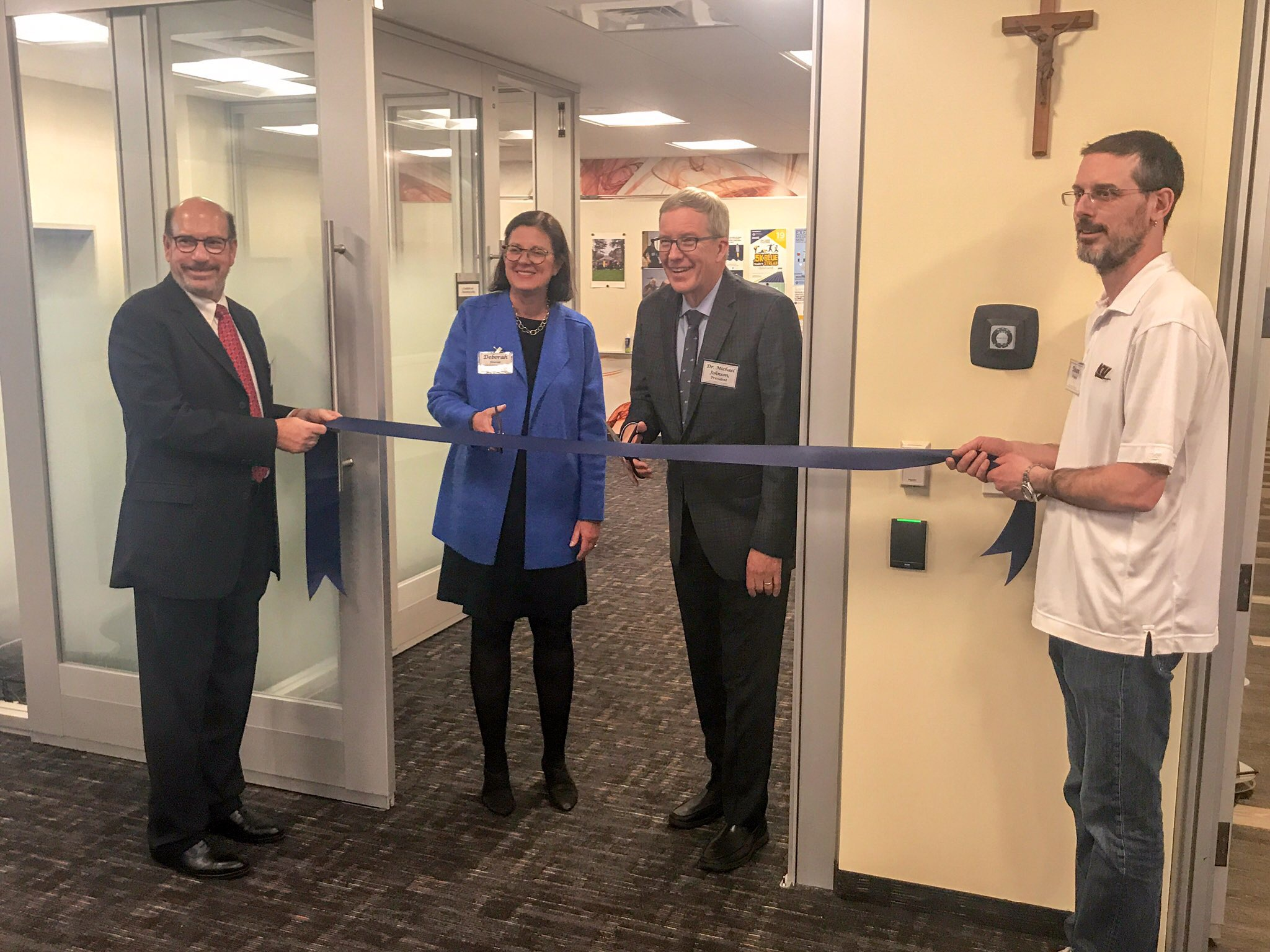Dr. Johnson and Deborah Hoover cut the ribbon on the LaunchNET classroom at JCU.