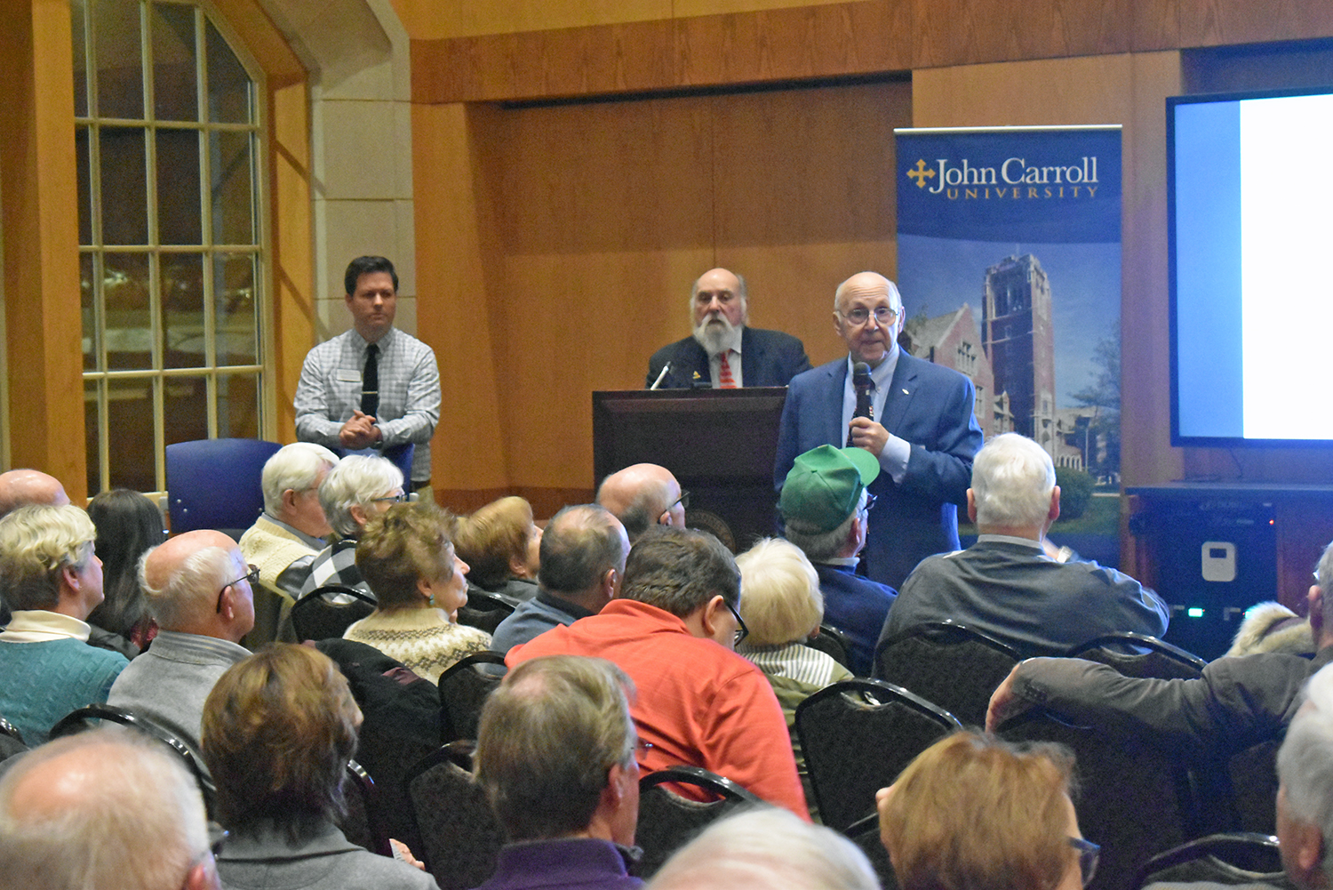 Pete Bernardo (right) and Dr. George Vourlojianis (center) answer audience questions following Tuesday's lecture.