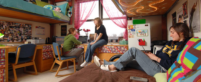 Students hanging out in a dorm room
