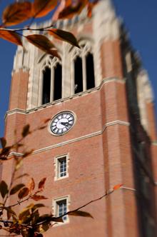 John Carroll University clock tower seen through leaves