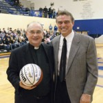 In February 2009 with Coach Mike Moran. JCU Athletics saluted members of the Society of Jesus and presented an autographed basketball to Fr. Niehoff as part of Ignatian Heritage Week.