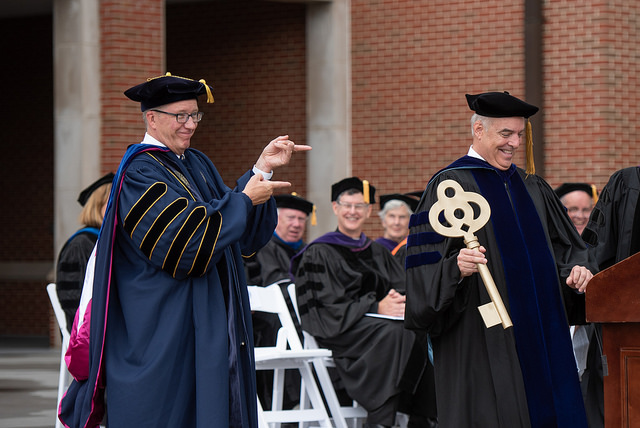 Dr. Johnson receives a giant key