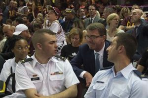 Defense Secretary Ash Carter talks to service members during Game 4 of the 2016 NBA Finals in Cleveland, June 10, 2016. Four service members representing the Army, Navy, Marine Corps and Air Force were honored on the court in a pre-game ceremony. DoD photo by Navy Petty Officer 1st Class Tim D. Godbee