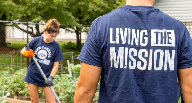 Student wearing living the mission shirt